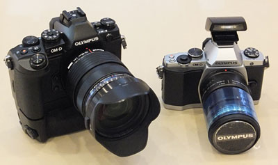 With the battery grip added, the E-M1 looks distinctively bulkier and more DSLR-like than its E-M5 predecessor.