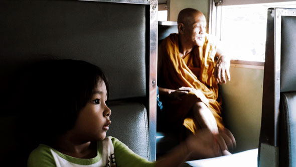 Girl and Monk on Train | Ronn Aldaman