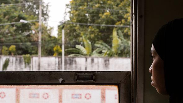 Muslim Woman on Train | Ronn Aldaman
