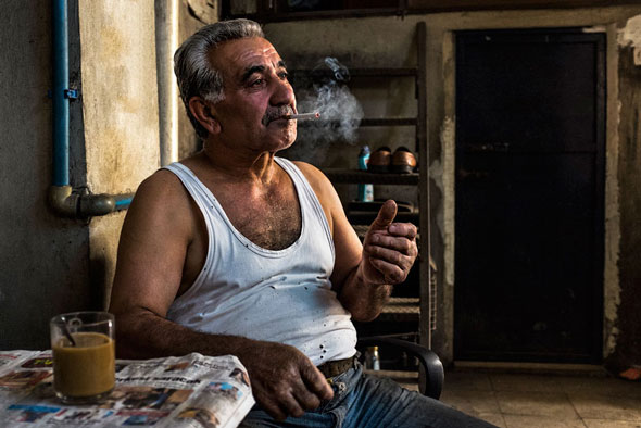 Chance encounters become photographs. While wondering around the streets of Istanbul, this gentleman invited me into his workshop. He is an ironsmith. He made me tea and tried to tell me, to not much avail, in Turkish about his life. What I did get was a portrait of him in a very natural pose, in part, because the camera was so small and non-confrontational and, again, because I actually had it with me, while wondering around the city. | EyeVoyage