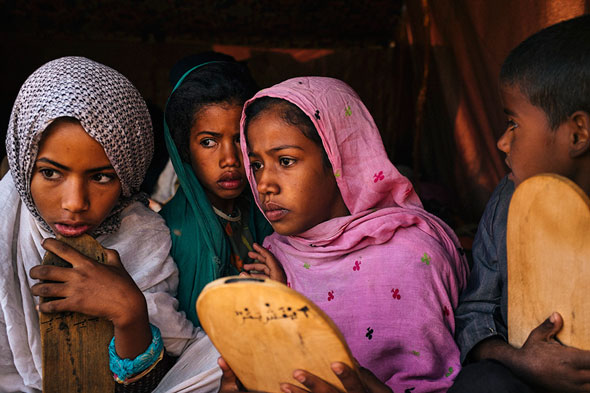 Here's a great example of the silent shutter benefit. A photograph taken in a nomadic Islamic school, called Mahardara in Mauritania. The kids were reciting the Qu'aran, I kept shooting throughout. They weren't very loud, so, shutter clicks would definitely get their attention, I'd likely distract them, which is not what I wanted at all. | EyeVoyage