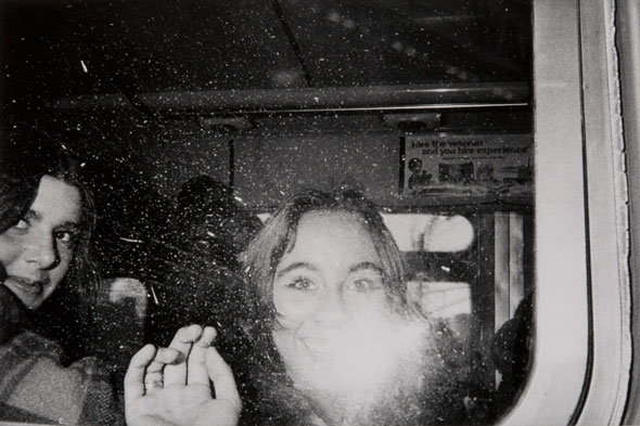 Untitled (girls' faces flashed in the bus window) | Mark Cohen