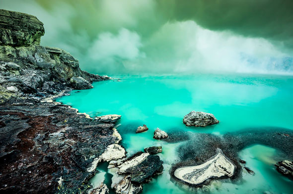 Shooting with gas mask mounted -- sulfur crater lake of Kawah Ijen volcano. | Stefan Forster