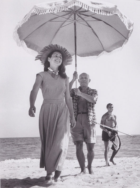 Golfe-Juan, France, August 1948: Pablo Picasso and Francoise Gilot. The man in the background is Picasso's nephew, Javier Vilato. | Robert Capa.