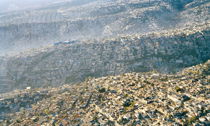 "Waves of Humanity Sprawling Mexico City rolls across the landscape, displacing every scrap of natural habitat. ""If our species had started with just two people at the time of the earliest agricultural practices some 10,000 years ago, and increased by one percent per year, today humanity would be a solid ball of flesh many thousand light years in diameter, and expanding with a radial velocity that, neglecting relativity, would be many times faster than the speed of light."" (Gabor Zovanyi) 
